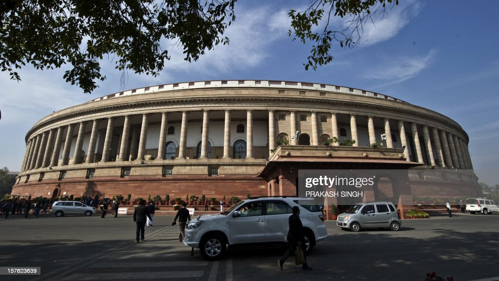 Indian MemberS of Parliament arrive at Parliament house during the winter session in New Delhi on December 5, 2012. India's government, which lost its majority in September, faced a test of its ability to marshal support in parliament on Wednesday with a vote on a contentious recent reform of the retail sector. After two days of stormy debating in the rowdy lower house, lawmakers are set to pass judgement on new rules opening up the highly protected retail sector to foreign supermarkets that are being allowed in for the first time. AFP PHOTO/ Prakash SINGH