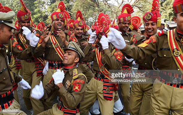 TOPSHOT Indian members of the Border Security Force dance as they wait to take part in a full dress rehearsal for the forthcoming Republic Day parade...