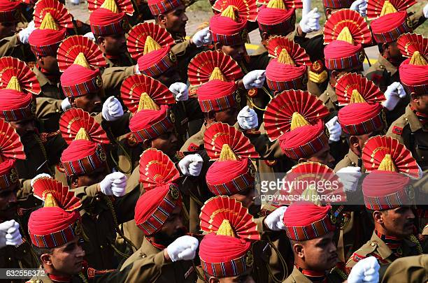 Indian members of the Border Security Force march during a full dress rehearsal for the forthcoming Republic Day parade in Kolkata on January 24 2017...