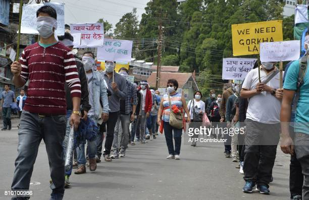 Indian members of the Lakshya Foundation and supporters of the separatist Gorkha Janamukti Morcha protest during the 23th day of an indefinite strike...