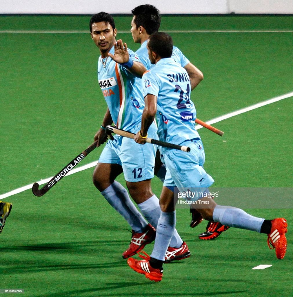 Indian Men Hockey Players Raghunath and Sunil celebrate after scoring the first goal against the Fiji during the Hockey World League Round 2 at Dhyan Chand Stadium on February 18, 2013 in New Delhi, India. It was a complete domination by Indian side as they trounced the Fijian side 8-0.