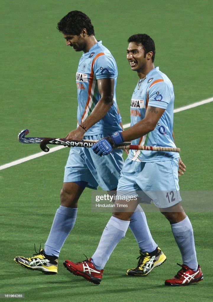 Indian Men Hockey Players Rupinder and Raghunath walks back after the first half against the Fiji during the Hockey World League Round 2 at Dhyan Chand Stadium on February 18, 2013 in New Delhi, India. It was a complete domination by Indian side as they trounced the Fijian side 8-0.