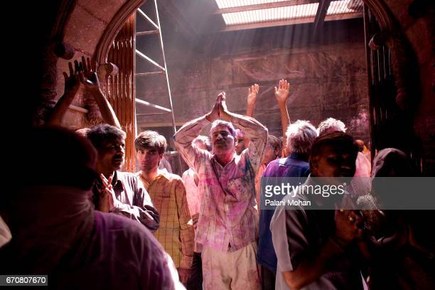 Indian men praying at the Sri Banke Bihari Temple as they celebrate Holi the festival of colour March 22 2008 in Vrindavan India Holi is celebrated...