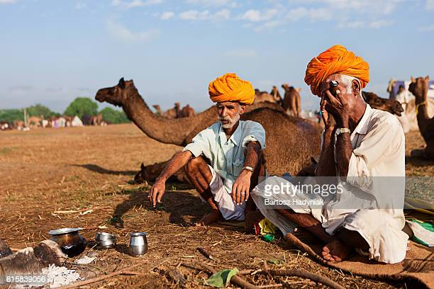 Indian men smoking the pipe during festival in Pushkar