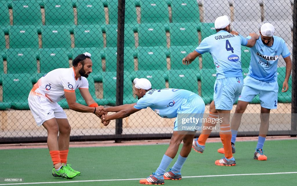 Indian men's Field Hockey team captain Sardar Singh (L) warms up with teammates during a training session at The Major Dhyan Chand National Stadium in New Delhi on April 1, 2015. The team is scheduled to leave for Malaysia for the Sultan Azlan Shah Cup on April 2.