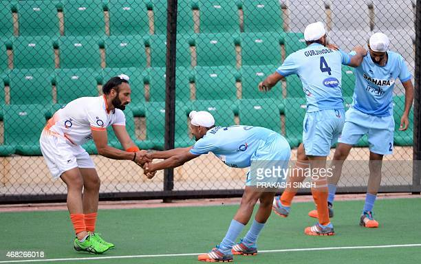 Indian men's Field Hockey team captain Sardar Singh warms up with teammates during a training session at The Major Dhyan Chand National Stadium in...