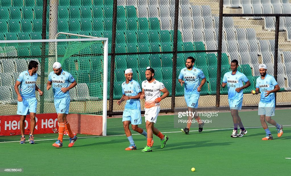 Indian men's Field Hockey team captain Sardar Singh (C) warms up with teammates during a training session at The Major Dhyan Chand National Stadium in New Delhi on April 1, 2015. The team is scheduled to leave for Malaysia for the Sultan Azlan Shah Cup on April 2, 2015.