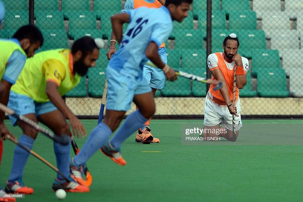 Indian mens Field Hockey team captain Sardar Singh (R) watches teammates during a training session at The Major Dhyan Chand National Stadium in New Delhi on April 1, 2015. The team is scheduled to leave for Malaysia for the Sultan Azlan Shah Cup on April 2.
