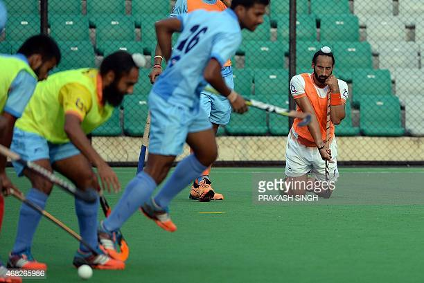 Indian mens Field Hockey team captain Sardar Singh watches teammates during a training session at The Major Dhyan Chand National Stadium in New Delhi...