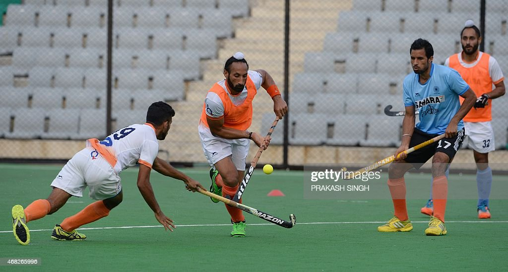 Indian mens Field Hockey team members including captain Sardar Singh (2L) take part in a training session at The Major Dhyan Chand National Stadium in New Delhi on April 1, 2015. The team is scheduled to leave for Malaysia for the Sultan Azlan Shah Cup on April 2. AFP PHOTO/ PRAKASH SINGH