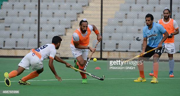 Indian mens Field Hockey team members including captain Sardar Singh take part in a training session at The Major Dhyan Chand National Stadium in New...
