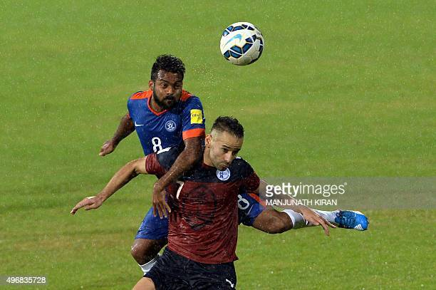Indian midfielder Cavin Peter Lobo and Guam's forward John Matkin head a ball during the the Asia Group D FIFA World Cup 2018 qualifying football...
