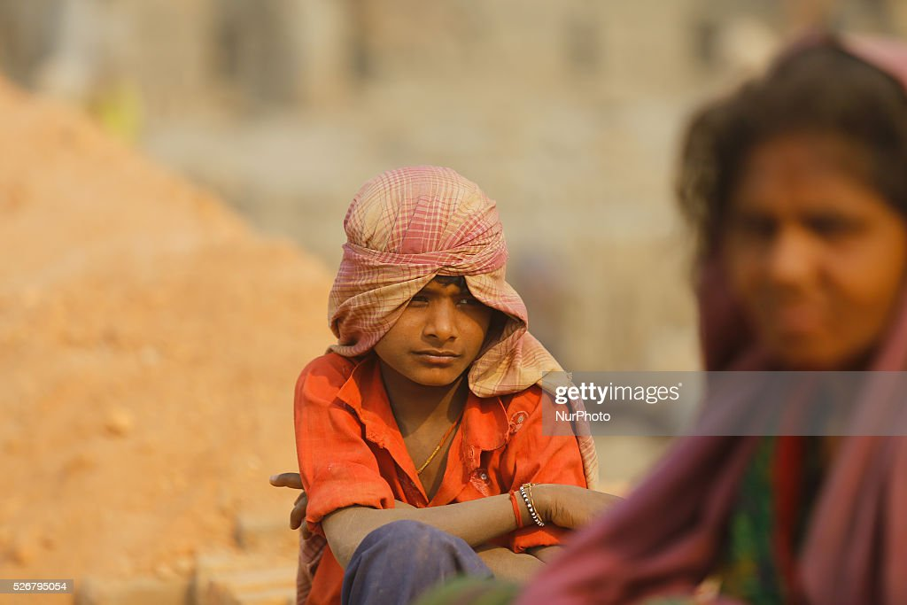 Indian migrant laborers carry bricks at a brick factory at Bungamati, on the outskirts of Kathmandu, Nepal, May 1, 2016. Seasonal migrant laborers from neighboring country and rural Nepal comes to Kathmandu valley every year to work at the brick factories.