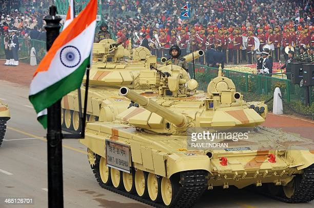 Indian military personnel drive Indian Army tanks as they take part in the Republic Day parade in New Delhi on January 26 2014 India celebrated its...