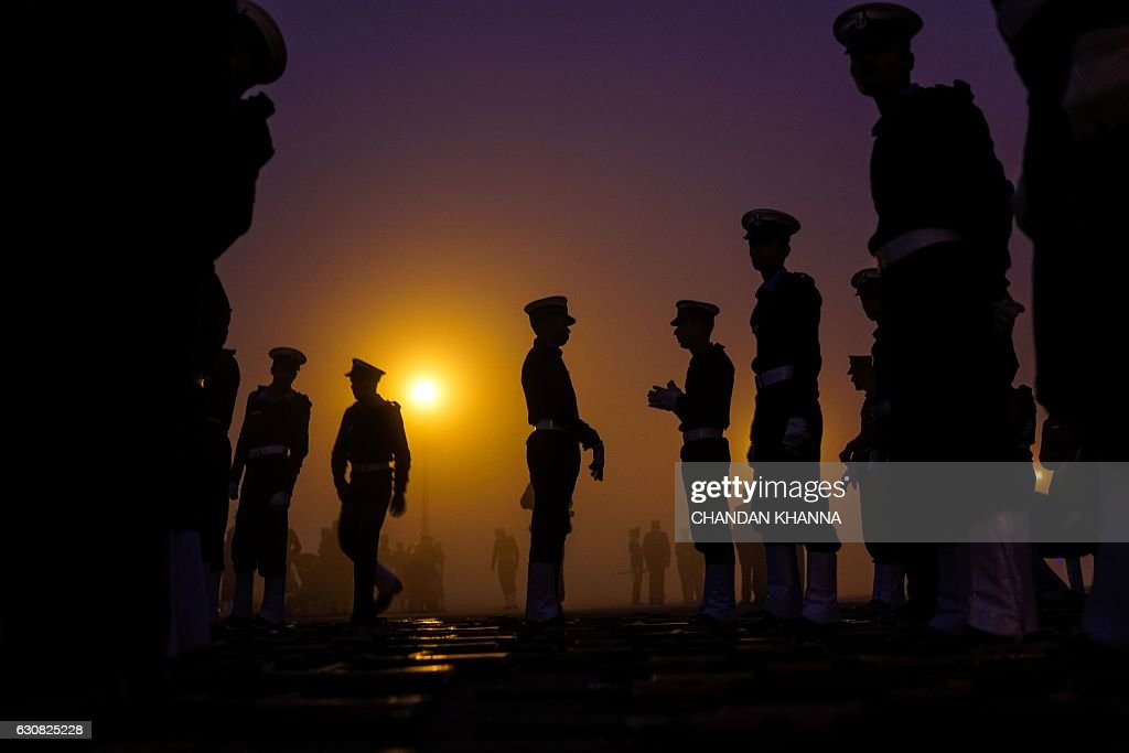TOPSHOT - Indian military personnel prepare to march as they rehearse for the forthcoming Republic Day parade at Rajpath in New Delhi on January 3, 2017. India will celebrate its 68th Republic Day on January 26 with a large military parade. / AFP / CHANDAN