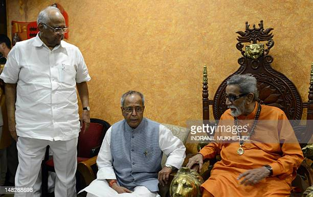 Indian minister for Agriculture Sharad Pawar watches as former Indian Finance Minister and frontrunner for the post of President of India Pranab...