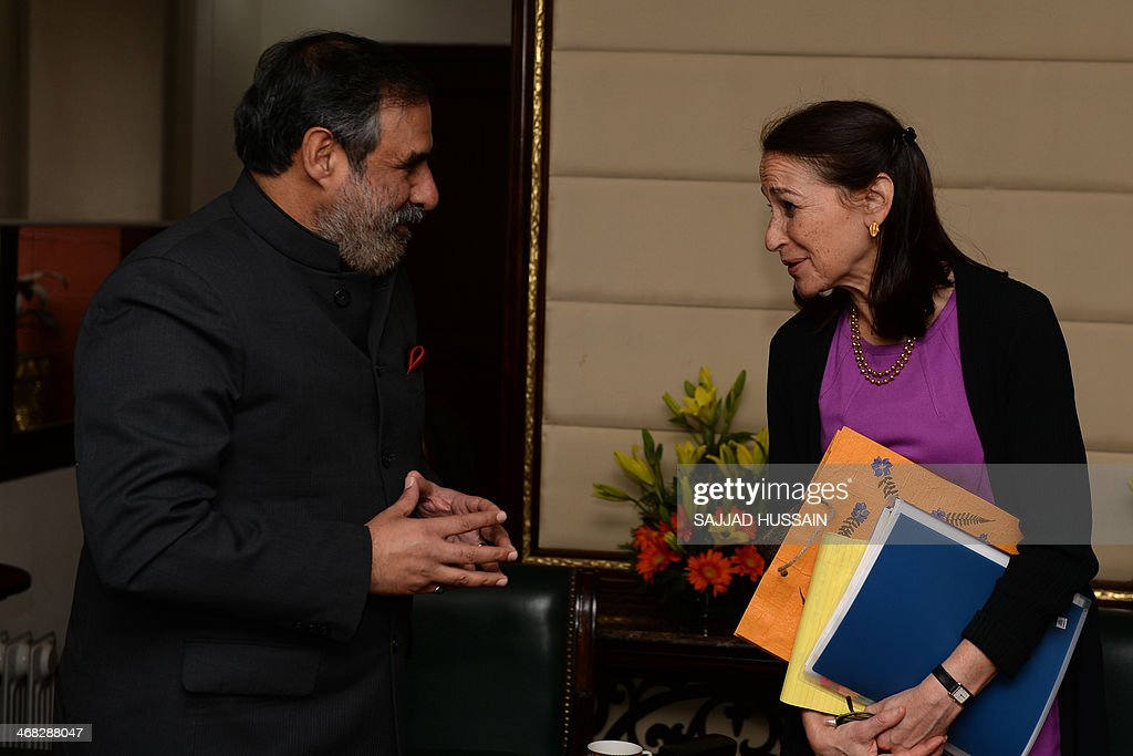 Indian Minister for Commerce and Industry, Anand Sharma (L) chats with Commissioner for US Food and Drug Administration, Margaret Hamburg after a meeting in New Delhi on February 10, 2014. Margaret Hamburg is on an official visit from February 8-10 to strengthen cooperation between the regulatory bodies.