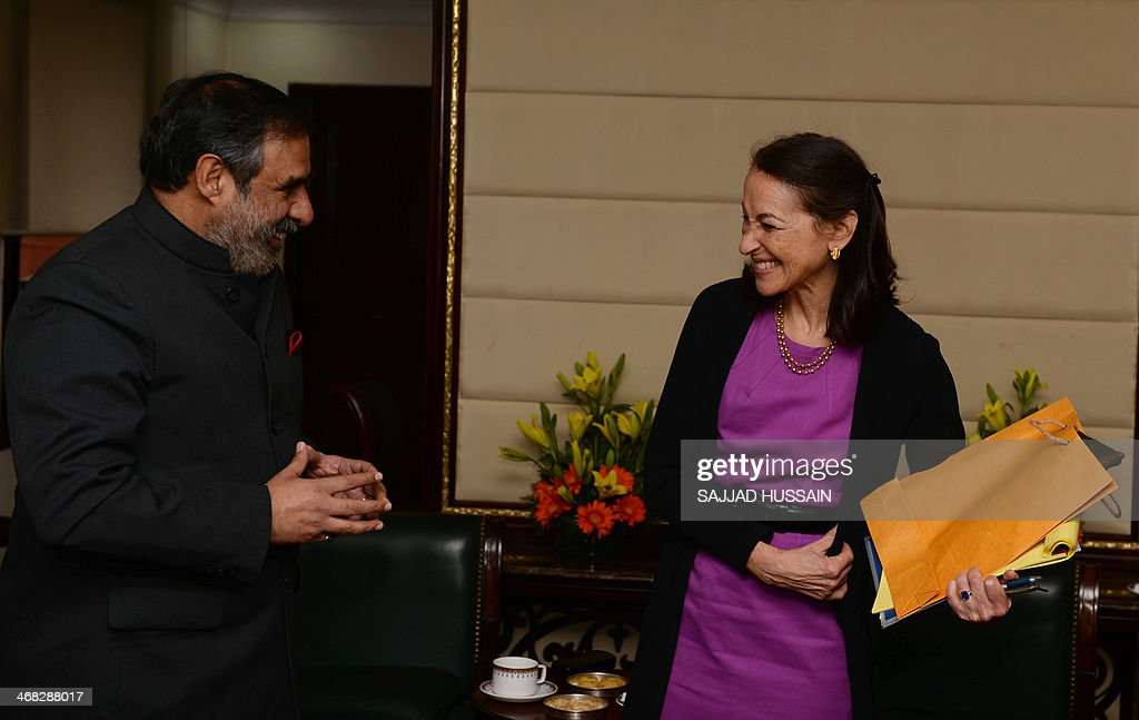 Indian Minister for Commerce and Industry, Anand Sharma (L) shares a light moment with Commissioner for US Food and Drug Administration, Margaret Hamburg after a meeting in New Delhi on February 10, 2014. Margaret Hamburg is on an official visit from February 8-10 to strengthen cooperation between the regulatory bodies.