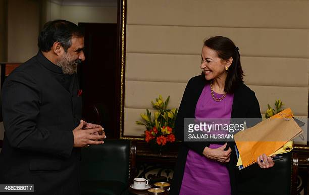 Indian Minister for Commerce and Industry Anand Sharma shares a light moment with Commissioner for US Food and Drug Administration Margaret Hamburg...