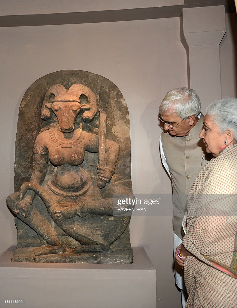 Indian Minister for External Affairs, Salman Khurshid (2R) and Minister of Culture, Chandresh Kumari Katoch inaugurate the 10th century stone sculpture of the 400 kg, 4.5 foot high 'Yogini' at the National Museum in New Delhi on September 19, 2013. The 10th century sculpture of a female deity with a buffalo head was acquired by French art collector Robert Schrimpf from an unnamed source and donated by his widow, Martine Schrimpf to the Indian embassy in Paris in 2008.