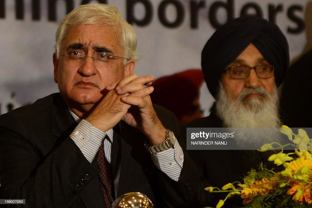 Indian Minister for External Affairs Salman Khurshid (L) and Punjab State Chief Minister Parkash Singh Badal (R) look on during the inauguration ceremony of the 8th South Asia Free Media Association (SAFMA) International Conference 2013 in Amritsar on January 6, 2013. About 200 members delegates from eight SAARC countries participated in the conference in Amritsar. AFP PHOTO/ NARINDER NANU