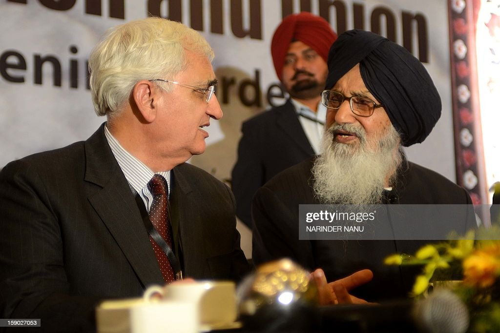 Indian Minister for External Affairs Salman Khurshid (L) and Punjab State Chief Minister Parkash Singh Badal (R) speak during the inauguration ceremony of the 8th South Asia Free Media Association (SAFMA) International Conference 2013 in Amritsar on January 6, 2013. About 200 members delegates from eight SAARC countries participated in the conference in Amritsar.