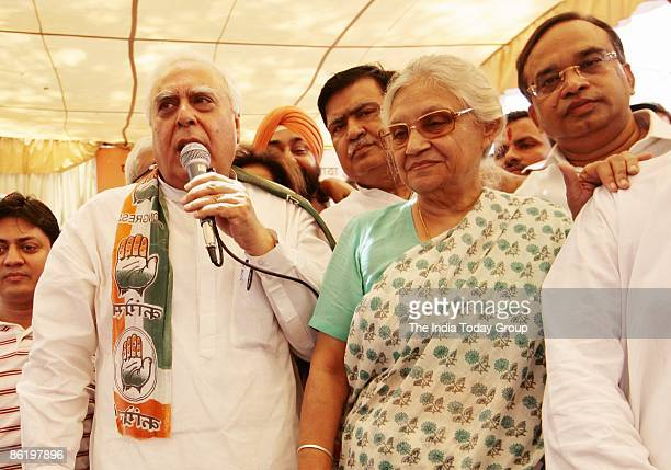 Indian Minister for Science and Technology and Ocean Development and Congress Party candidate for Chandni Chowk Kapil Sibal with Delhi Chief Minister...