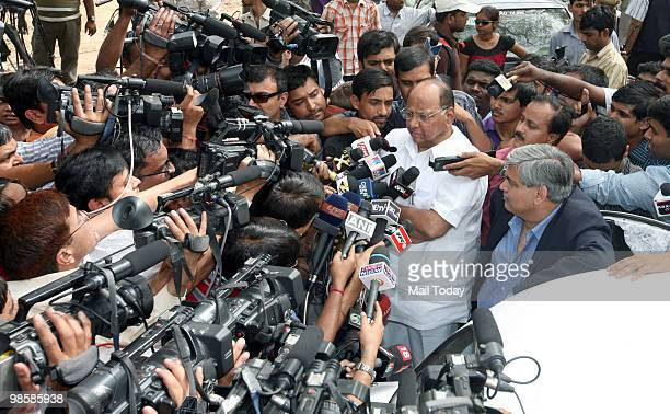 Indian Minister of Agriculture Sharad Pawar addresses the media as Board of Control for Cricket in India chief Shashank Manohar looks on at Pawar's...