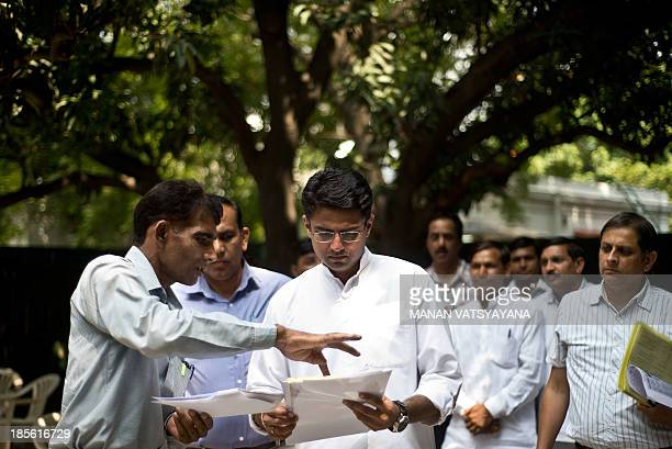 Indian Minister of Corporate Affairs Sachin Pilot interacts with party workers at his residence in New Delhi on September 27 2013 AFP PHOTO/ MANAN...