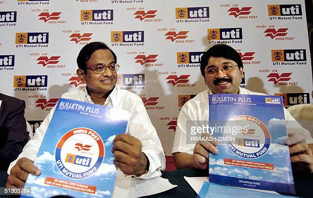 Indian Minister of Finance P Chidambaram and Indian Minister of Communications and Information Technology Dayanidhi Maran show a booklet released by...