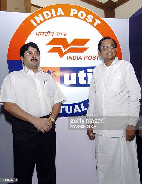 Indian Minister of Finance P Chidambaram and Indian Minister of Communications and Information Technology Dayanidhi Maran pose next to a jointlogo...