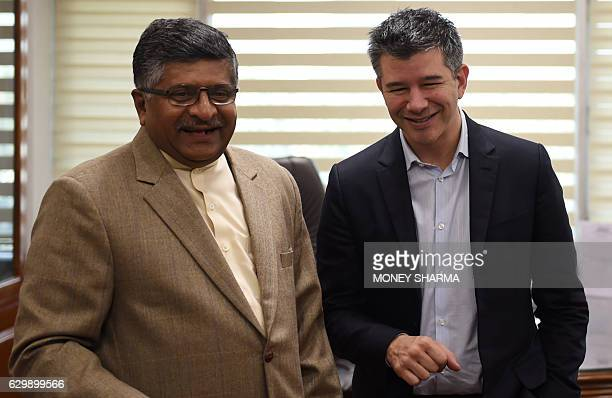 Indian Minister of Law and Justice and Ministry of Information Technology Ravi Shankar Prasad shares a light moment with cofounder and CEO of Uber...