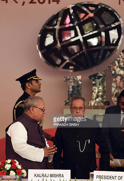 Indian Minister of Micro Small and Medium Enterprises Kalraj Mishra welcomes Indian President Pranab Mukherjee during the inauguration of 34th Indian...