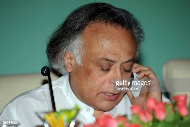 Indian Minister of State for Environment and Forests Jairam Ramesh speaks on a cellular telephone as he attends the Indian Network for Climate Change...