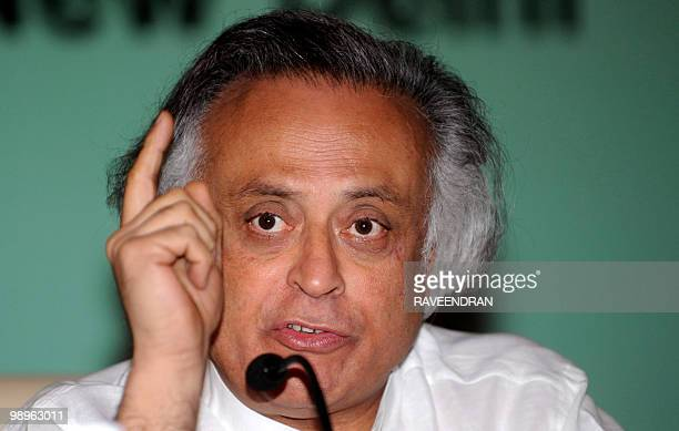 Indian Minister of State for Environment and Forests Jairam Ramesh gestures as he attends the Indian Network for Climate Change Assesment and India...