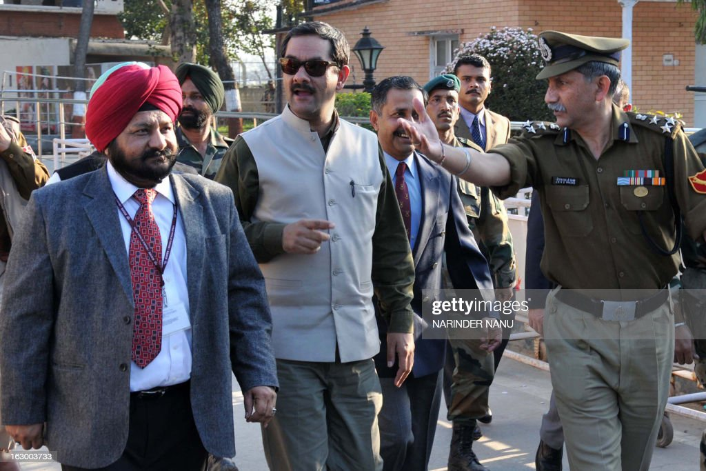 Indian Minister of State Sports and Youth Affairs, Jitendra Singh (C) is escorted by Indian Border Security Force (BSF) officers on his arrival at the international India-Pakistan Wagah Border on March 3, 2013. Singh visited to inspect the newly constructed Integrated Check Post (ICP) and also watch the beating retreat ceremony at Wagah border.