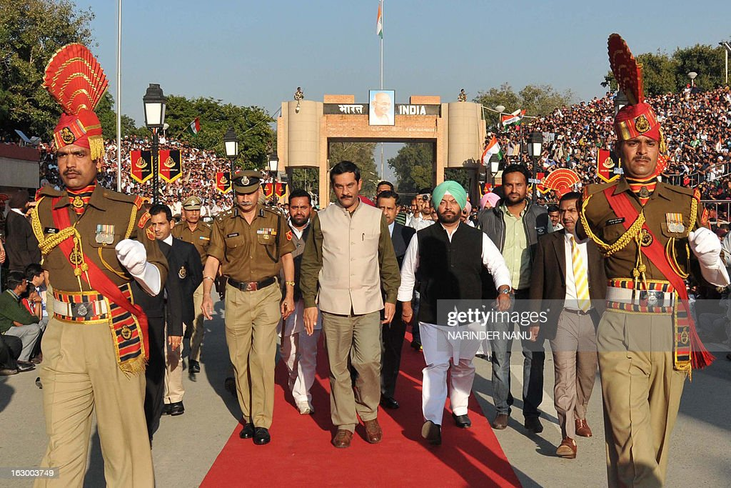 Indian Minister of State Sports and Youth Affairs, Jitendra Singh (C) is escorted by Indian Border Security Force (BSF) soldiers on his arrival at the international India-Pakistan Wagah Border on March 3, 2013. Singh visited to inspect the newly constructed Integrated Check Post (ICP) and also watch the beating retreat ceremony at Wagah border.