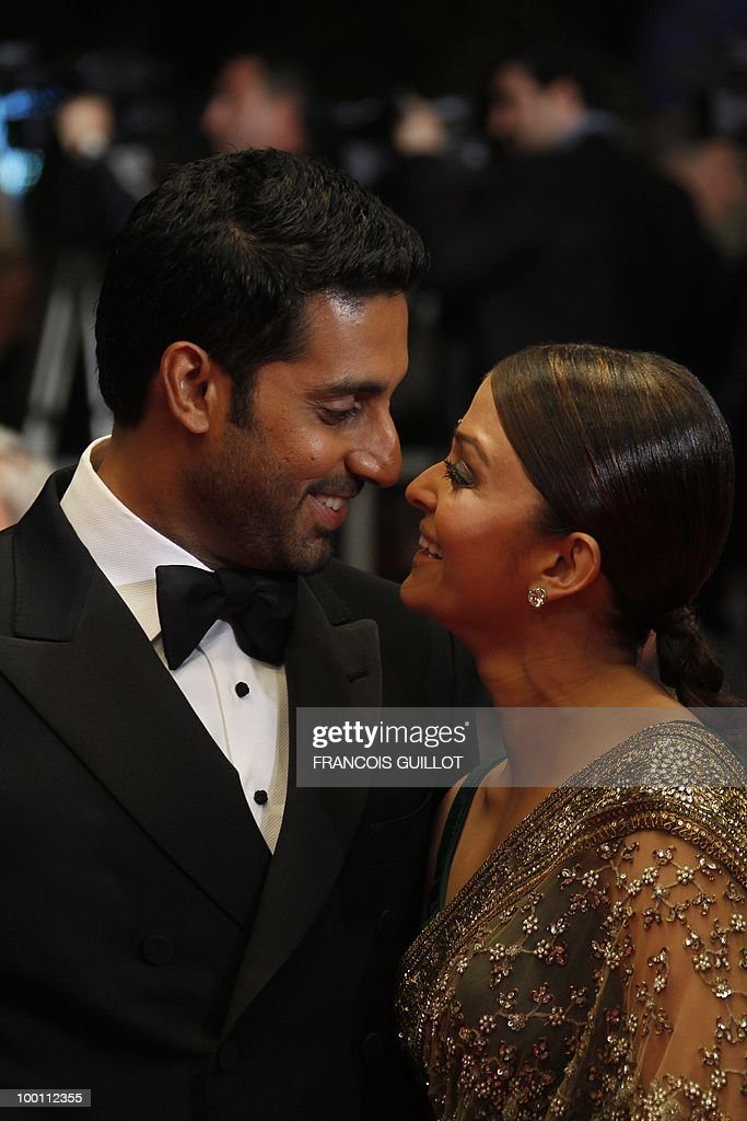 Indian model Aishwarya Rai and husband Abhishek Bachchan arrive for the screening of 'Outrage' presented in competition at the 63rd Cannes Film Festival on May 17, 2010 in Cannes.