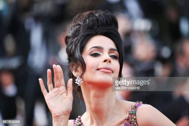 Indian model and actress Mallika Sherawat poses a she arrives on May 24 2017 for the screening of the film 'The Beguiled' at the 70th edition of the...