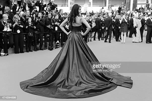 Indian model and actress Mallika Sherawat poses as she arrives for the screening of the film 'Macbeth' at the 68th Cannes Film Festival in Cannes...