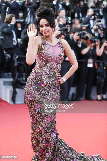 Indian model and actress Mallika Sherawat poses as she arrives on May 24 2017 for the screening of the film 'The Beguiled' at the 70th edition of the...