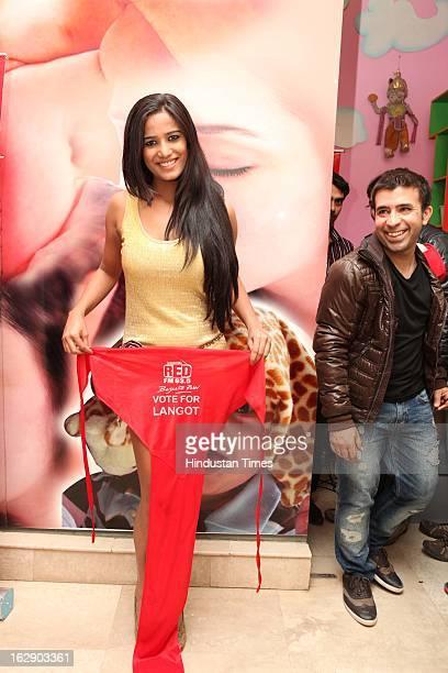 Indian model and actress Poonam Pandey posing with Langot during 'Vote For Langot' Wrestling competition organized by Red FM Radio Channel to support...