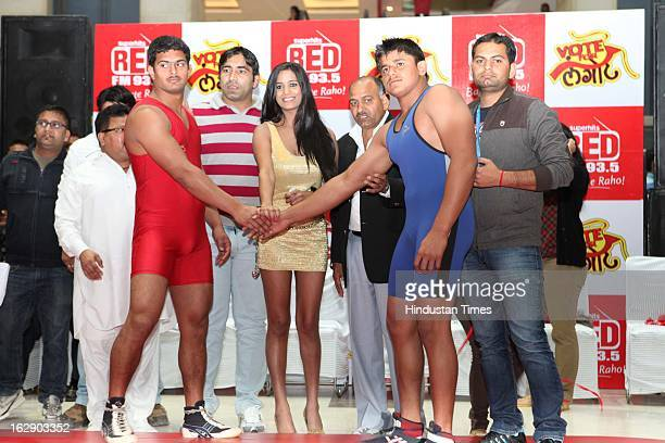 Indian model and actress Poonam Pandey with participants during 'Vote For Langot' Wrestling competition organized by Red FM Radio Channel to support...