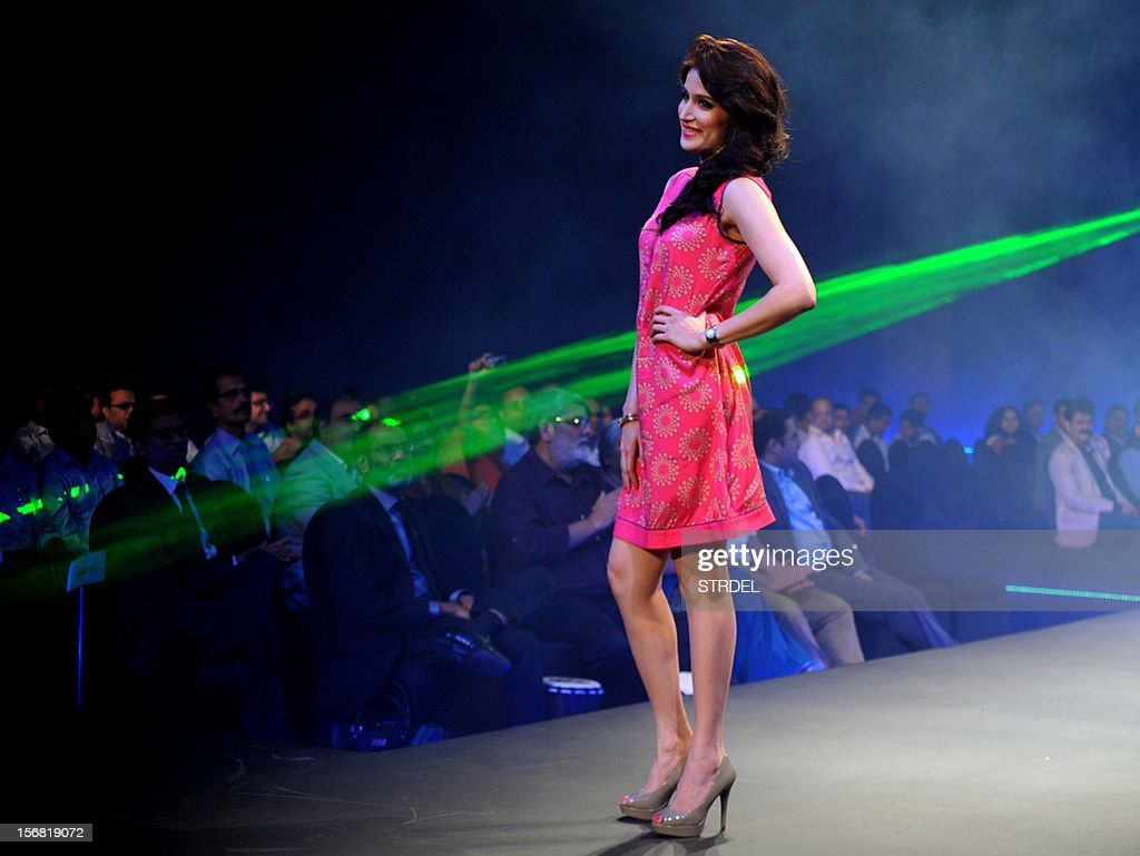 Indian model and actress Sagarika Ghatge walks the ramp during a Future Lifestyle Fashion event in Mumbai on November 21, 2012. AFP PHOTO/STR