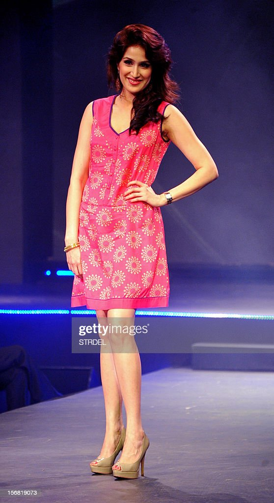 Indian model and actress Sagarika Ghatge walks the ramp during a Future Lifestyle Fashion event in Mumbai on November 21, 2012.