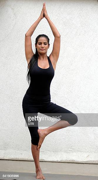 Indian model and Bollywood actress Poonam Pandey performs as she marks International Yoga Day in Mumbai on June 21 2016 / AFP / STR