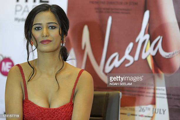 Indian model and bollywood film actress Poonam Pandey poses during a promotional event for her upcoming debut movie 'Nasha' in Hyderabad on July 21...