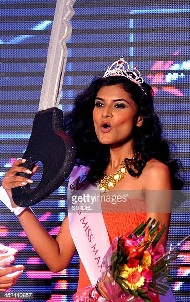 Indian model and KamaSutra Miss Maxim 2014 winner Swapnila Gupta walks the ramp at the competition final in Mumbai on November 28 2013 AFP PHOTO/STR