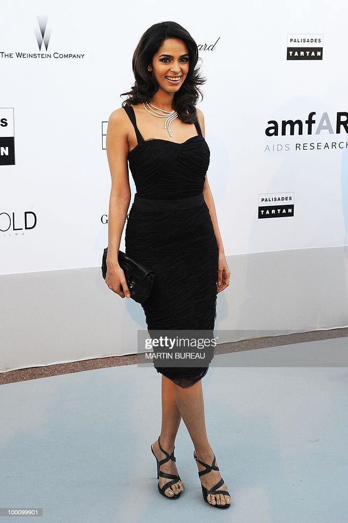 Indian model Mallika Sherawat arrives at amfAR's Cinema Against Aids 2010 benefit gala on May 20, 2010 in Antibes, southeastern France.