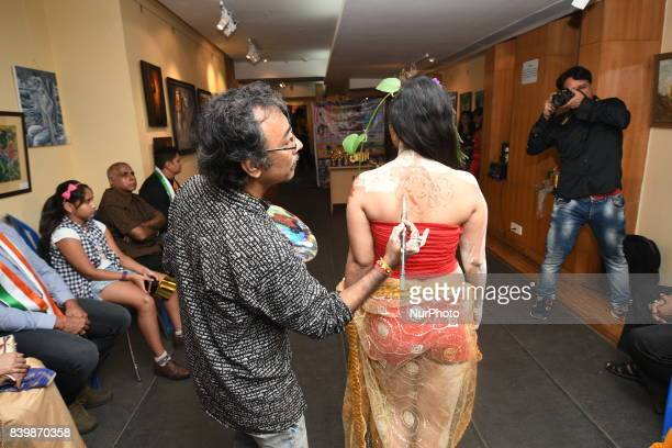 Indian Model participates at The Live Body Penting Art show organized by Creative Dream in Kolkata India on 13 August 2017 Body painting or sometimes...